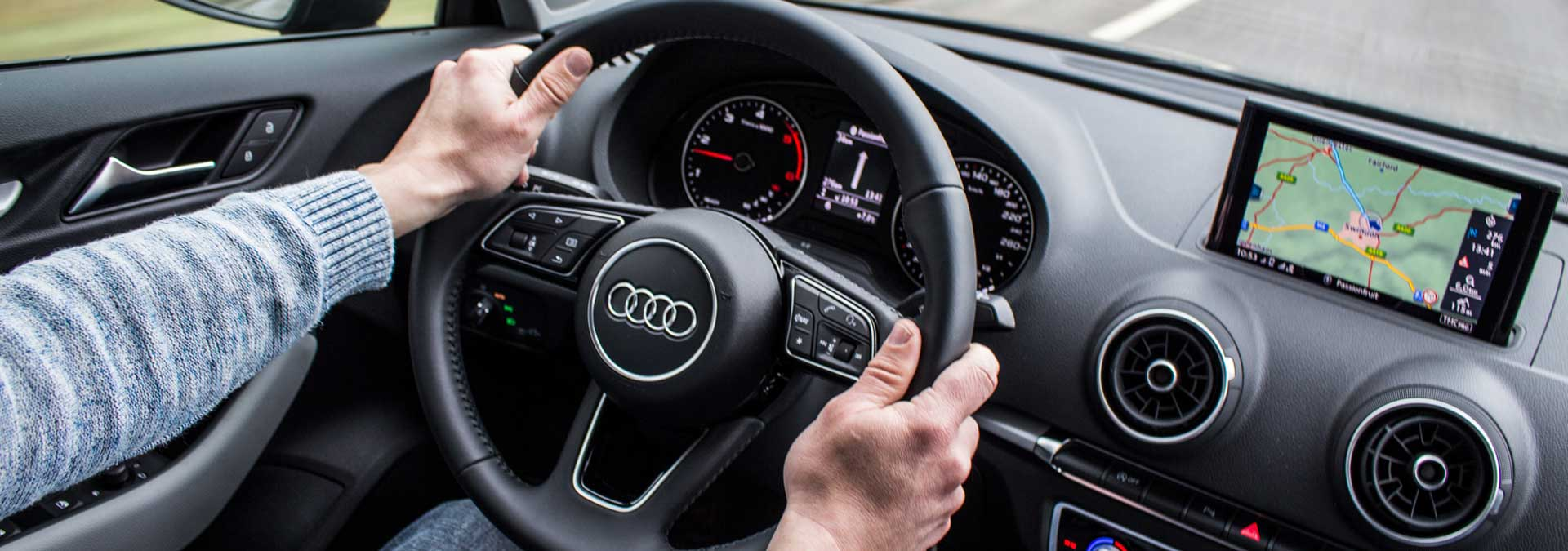 mature driver driving an Audi equipped with GPS