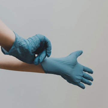 Putting on latex gloves before driving